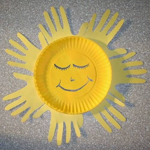 Handprint sun craft. Use your child's hand print to make the beautiful rays for this paper plate craft.