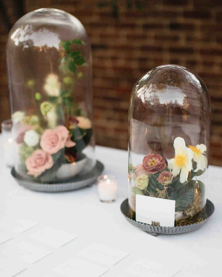 A Backyard, Garden Wedding in San Marino | Martha Stewart Weddings - Guests found their names and seating assignments on a table adorned with these cloches featuring Japanese-inspired floral arrangements.