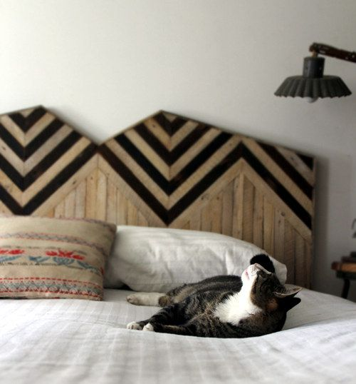 pretty cool handmade wooden headboard. i love the detail. minus the cat.
