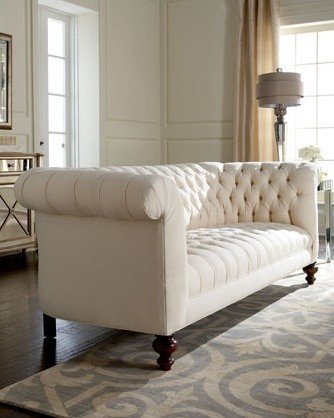 white Chesterfield sofa. Chesterfields are deep, tufted sofas with arms and back…
