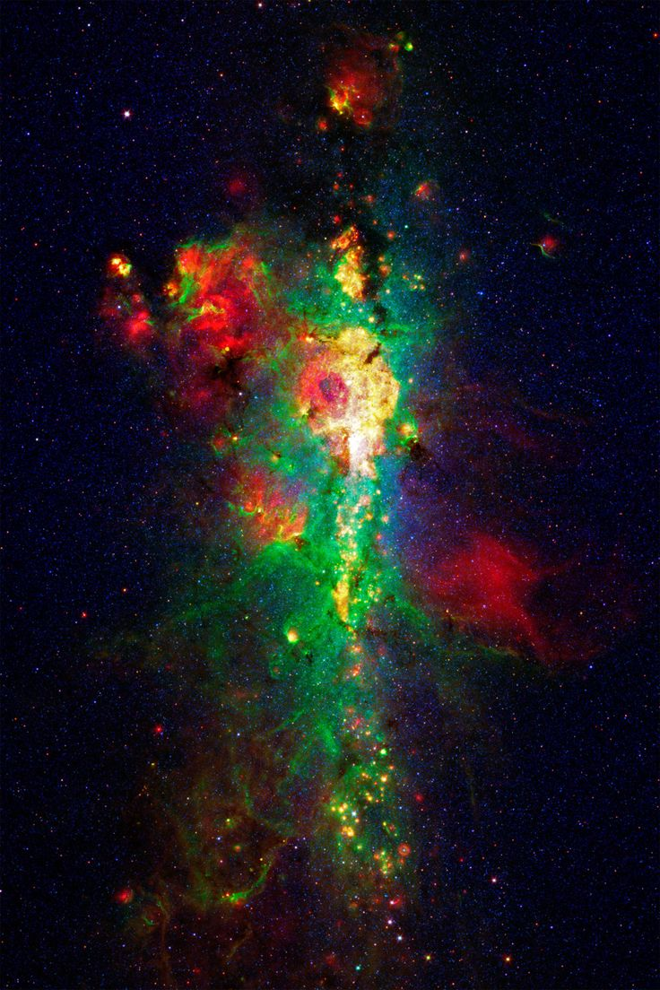The Core of our Galxy, seen in infrared light by the Spitzer Space Telescope. Blue light is from stars, green light is from polycyclic carbon molecules, yellow and red light is from the thermal glow of warm dust. This image spans approximately 1000 light years by 1600 light years. The galactic core is 26,000 light years away.