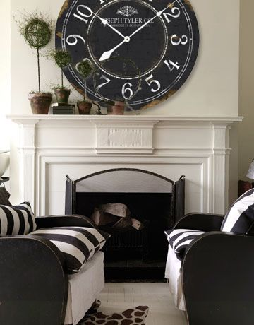 WOW looks great with this black and white living space.  Find this clock at http://www.clocksaroundtheworld.com/large-wall-clocks.html