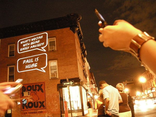Text bubble frames are projected onto walls along with images. Passersby send text messages to a projected number, and these messages are then cycled through the text bubbles.
