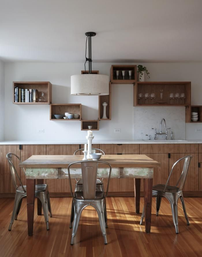 Remodelista, Workstead, Brooklyn Heights, cherry hardwood storage boxes on white kitchen wall, pendant light over table