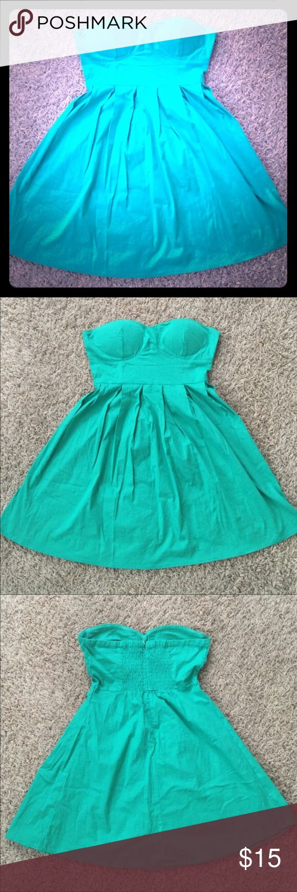 Body Central strapless sundress Super cute. Such a pretty green. Can be dressed up or worn casual. Built in cups for support. Never worn. Let me know if you have any questions. Only offers made with the offer button will be considered. Body Central Dresses Mini