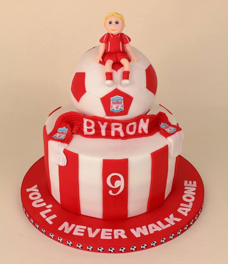 Liverpool FC cake with football and liverpool scarf.