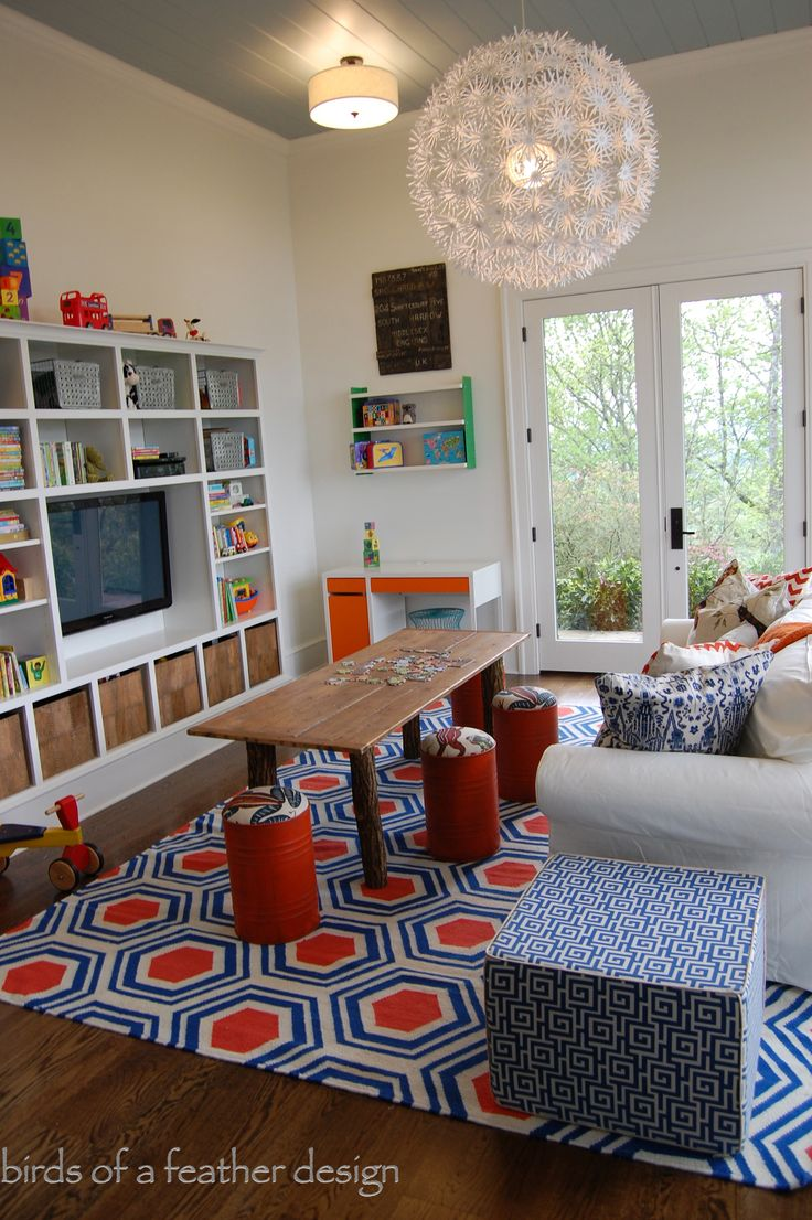 The floor cushion/ottoman is from HomeGoods and adds comfy seating in this vibrant playroom.