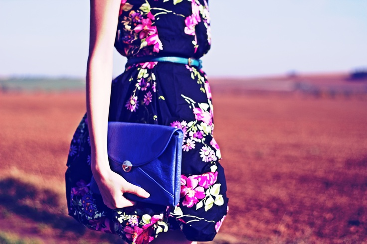 floral dress and blue clutch