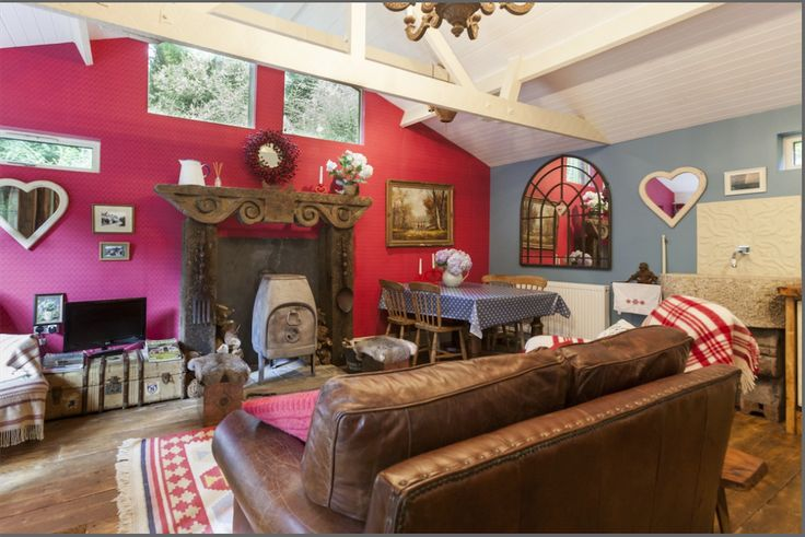 DEVON: Colourful living room at The Secret Holt in Haytor, Devon. Cosy and very cute, the vibrant colours complement each other well and the room exudes comfort and alpine chic.