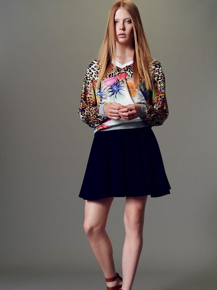 Naughty Dog SS15 tropical animalier silk blouse and black fleece skirt.