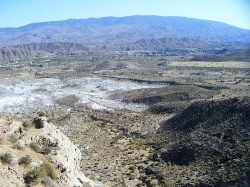 Yes Spain Has a desert.  The Tabernas Desert is between a mountain range called Sierra de los Filabres to the north and the Sierra de Alhamilla...