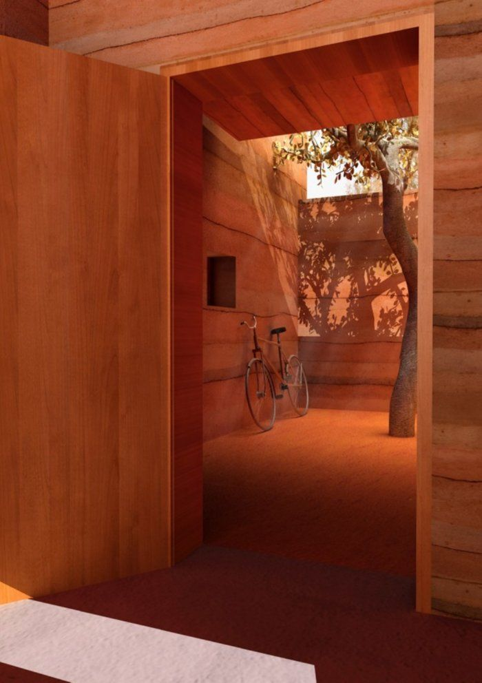 rammed earth house - close up of variations using coloured sand