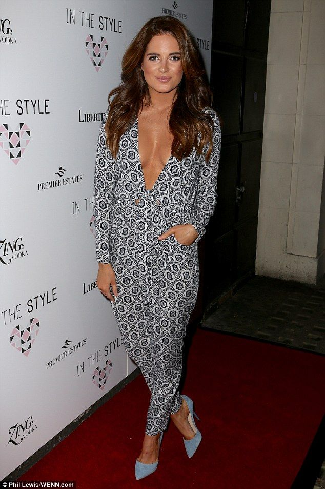 Busty babe: Binky Felstead proved herself to be her own best advertisement as she stepped out in a sexy jumpsuit at the star-studded launch of her In The Style clothing range on Thursday night