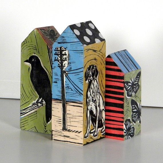 Blocks of wood with an original linoleum block print on each side by Lisa Kesler. I love these!