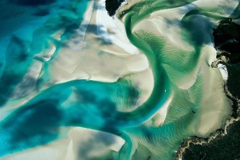 aerial photo of sandbanks at low tide off Whitsunday Island, Australia | photo credit yannarthursbertrand2