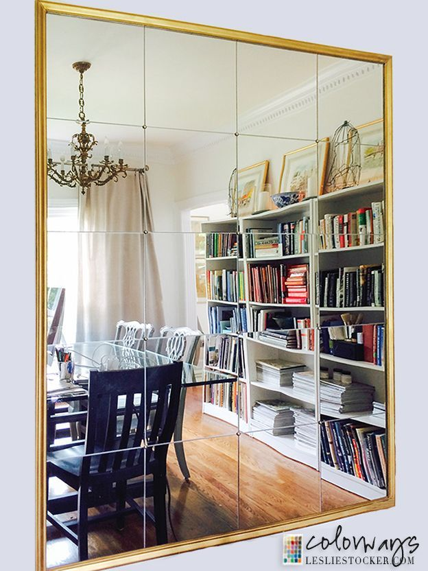 DIY mirror using mirror tiles and brass nail head tacks. Inspired By Pottery Barn