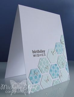 The Card Grotto: Hexagons Birthday Card.  This card is so simple and sweet, we fell in love!  Use a hexagon punch with a cardstock with a smaller pattern to fill the space.  Embellish with tiny butterflies and gems.  For patterned crafting cardstock, visit us at www.cardstockshop.com.