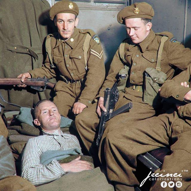 """the_ww2_memoirs William Joyce or more commonly known as """"Lord Haw Haw"""" stares blankly away from the camera as his escort of armed guards makes sure he takes no actions towards escaping after being captured in his house in Germany, May, 1945. This is one of the few captions that actual requires research from myself and most of my information as come from the reliable source that is called WW2 Colorized Photos on Facebook. If you don't know that's where I get a lot of my photos but that's off…"""