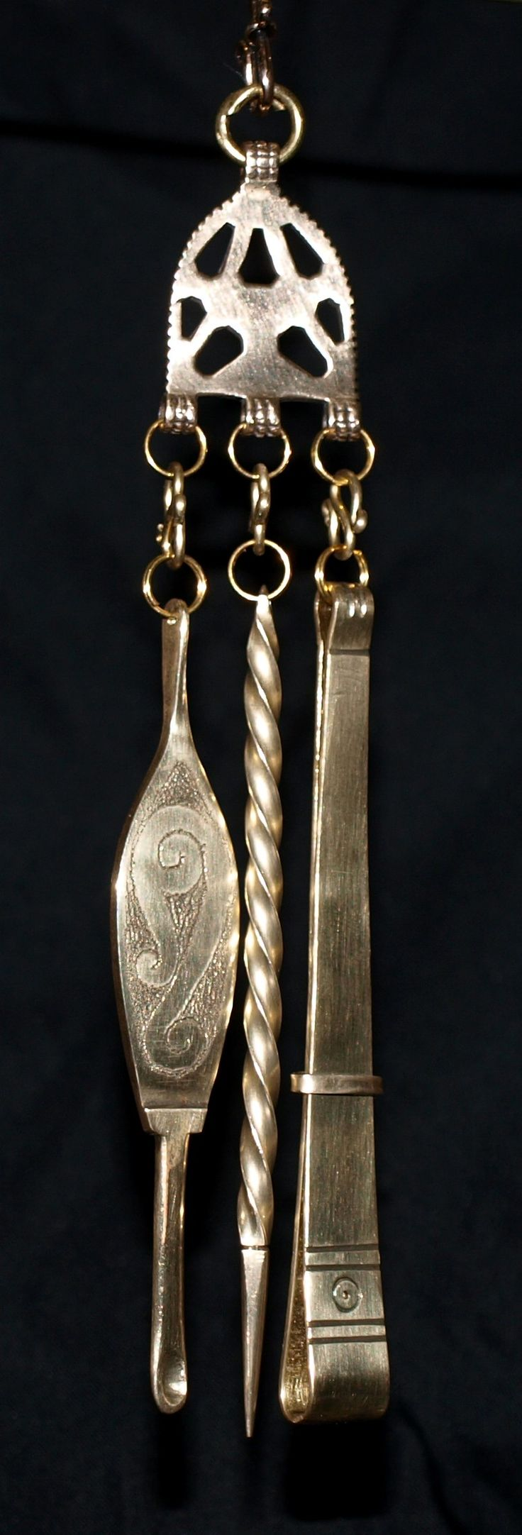 Viking toiletries; ear spoon, pick, tweezers. I like the ear spoon, don't want to think about what the pick might be for!