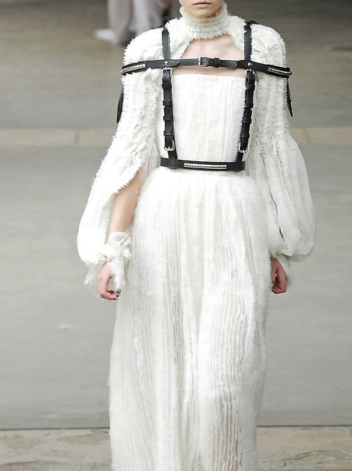 harness over white dress
