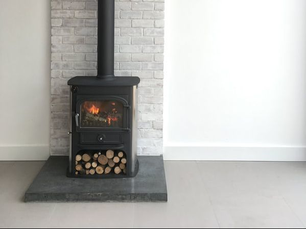 Polished Concrete Modern Industrial Hearth with White Washed Brick Wall Back