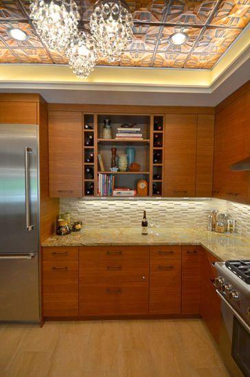 Tin ceiling, marble backsplash, Exotic wood veneer...the beauty is in the details! #Homecomfort