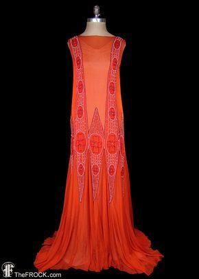 1920s flapper gown, pumpkin orange silk chiffon, rhinestones and glass beads, red beads and trims, sleeveless, mermaid trumpet hem, couture