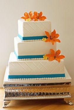 turquoise and orange wedding cake..... like the turquoise and the shape of it