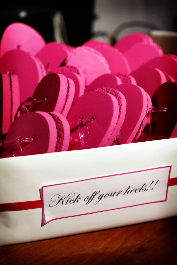 hot pink guest flip flops - photo by destination wedding photographers Chris plus Lynn
