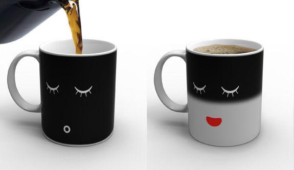 Morning Mug   ::    Designer: Damian O'Sullivan  ::  When cold, his morning mug displays a sleeping face white on black. As you pour in the hot coffee (or tea), the mug awakens to greet you.