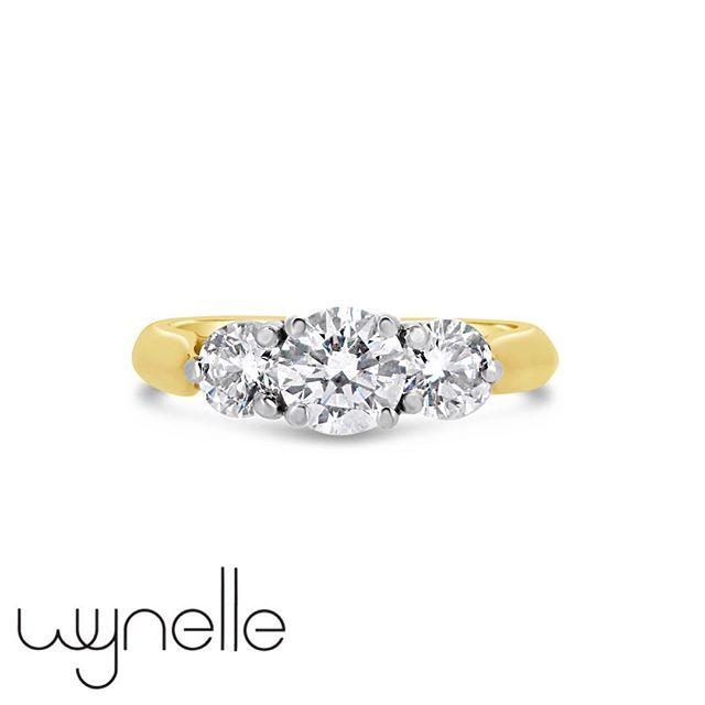 Encapsulating Elegance! Round Brilliant Cut Three Stone Engagement Ring.