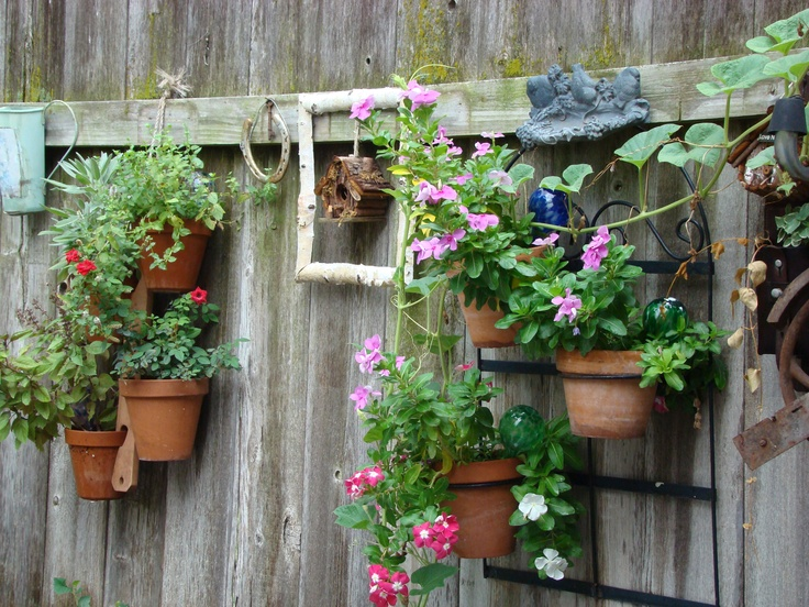 Fence decorated with old things flowers and herbs my for Fence ornaments ideas
