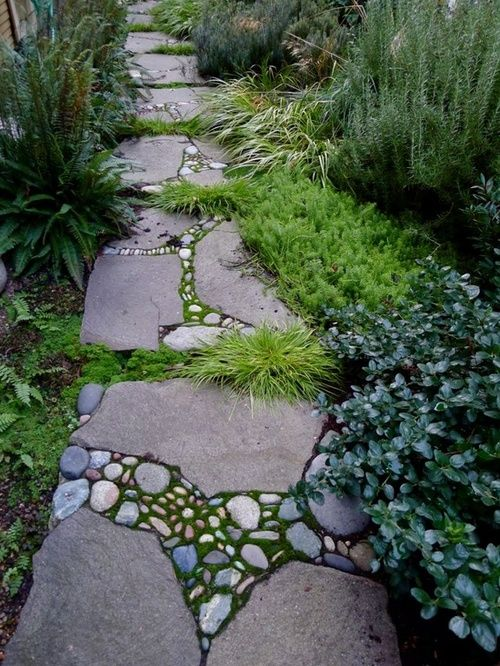 Stone Mosaic / garden path. I bet this would work using decomposed granite, instead of a grout, around the tiny stones. This would be easy and really creative. And still allow water to permeate into the ground.
