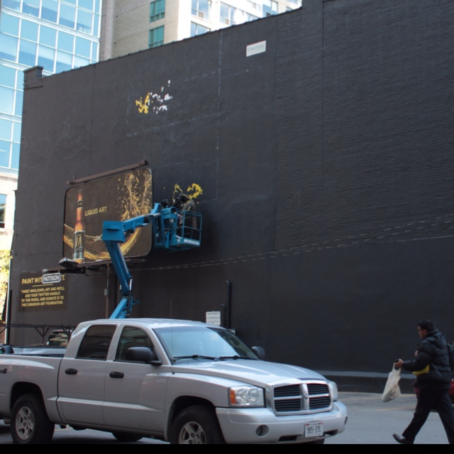 Molson M is urging Twitter users to tweet the hashtag #MolsonM_Art to power the painting of a wall mural and drive $1/tweet donations to the Canadian Art Foundation.   The giant mural in the King/Church area of Toronto got its first strokes of paint today.