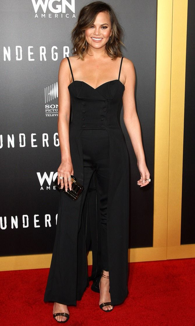 Chrissy Teigen in a black Jean Paul Gaultier dress