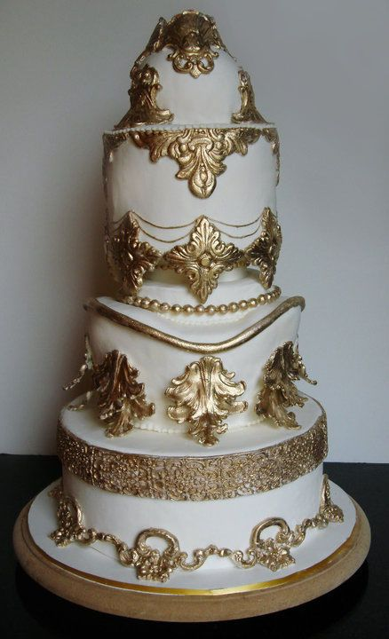 Baroque style cake - This cake was made for a wedding of a very traditional family who wanted to portray exuberance, opulence and glamour.  Many molds were made to create some of the shapes on this cake