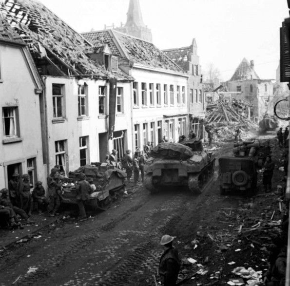43rd (Wessex) Division troops and vehicles in the main street of Xanten, 11 March 1945.