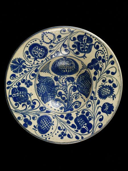 "18th century Romanian Dish at the Victoria and Albert Museum, London - From the curators' comments: ""It is believed that potters from the western, Hungarian, part of the kingdom had settled in the region in the 17th century bringing their technique of slipware decoration. Combining this technique with a sombre palette of blue on white, perhaps in imitation of the decoration on Rhineland stoneware, they produced a distinctive pottery form characteristic of Tara Barsei."""