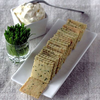 Sour Cream And Chive Crackers 3/4 oz chives  2 c. flour  2 1/2 oz sour cream 1 tsp salt 1/2 tsp garlic powder mix ingredients, knead until smooth, roll with rolling pin until very thin, cut into squares, bake @ 250 for 50-60 mins checking to make sure they don't burn, break into squares and serve!