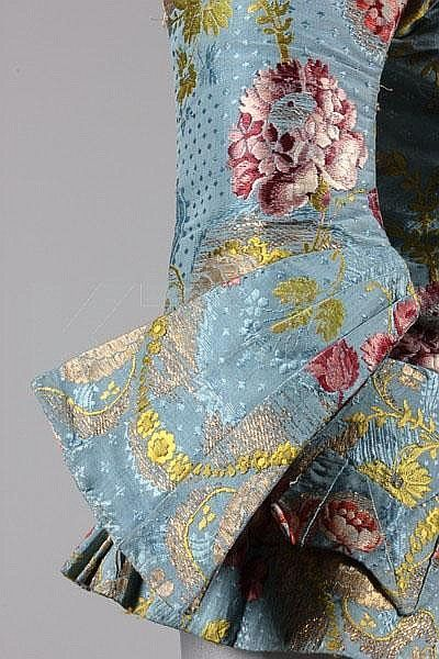 Detail cuffs caraco jacket, c. 1740-50s. Sky blue brocaded silk (probably Spitalfields) with gold and silver leaf scrolls and floral motifs in coloured silk. Winged cuffs, short peplum skirt with two faux pockets.