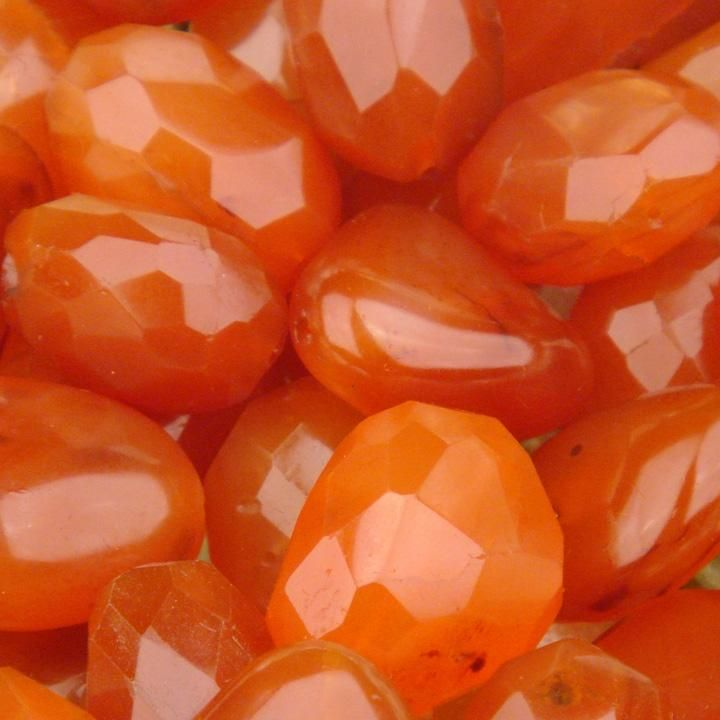 "Carnelian, the ""Stone of Grounding,"" shields you from fear and anxiety and encourages a stress-free state of bliss. It is used for clearing energy to bring about a state of peace and euphoria to your soul. (Although Peridot is the customary birth stone for August, this is the alternative one. I think its beautiful & ranges from pale melon to deep red coloring)"