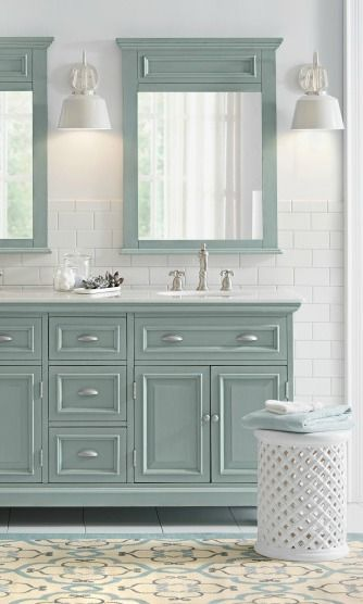 Pull together a stylish master bathroom remodel with an ocean-inspired color palette. Blogger, In All Places shows how a classic subway tile backsplash can add a fresh feel to your space as well.