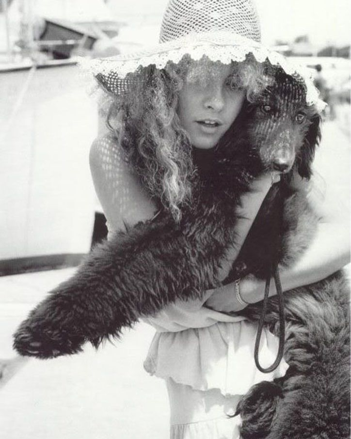 Nothing more beautiful that holding your dog on a sunny day in a wide brimmed hat. #stevienicks #fleetwoodmac #mac #coven #sunny #photograph #filmphotography #lindseybuckingham #poodle #dogsofinstgram #dogs