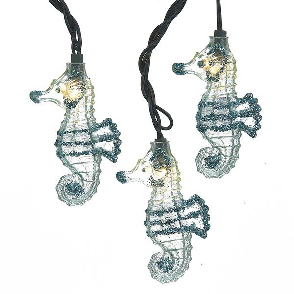 This Kurt Adler UL 10 light glittered Seahorse light set is a fun and unique addition to any holiday or theme party décor. Each of the ten lights in this novelty light set has an adorable clear seahorse lined in blue glitter. Each set has a green lead wire and is for both indoor and outdoor use.