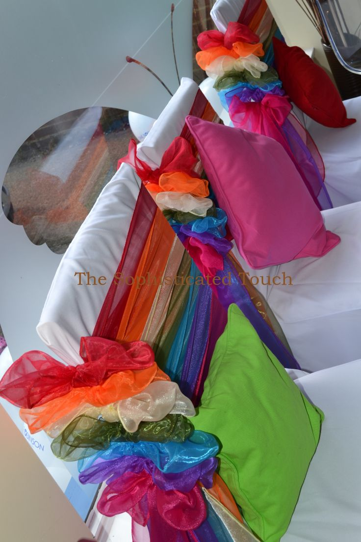 Rainbow Bows on White Chair Covers    The Sophisticated Touch ...Chair Covers by Design