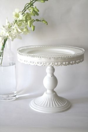 vintage shabby chic white cake stand { by montresor.com.au}  Candle stick topped with a plate and circled by lace/ribbon