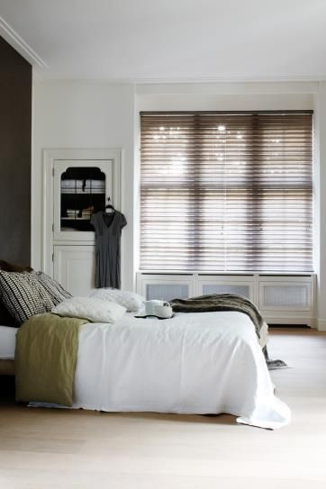 Fabric blinds are available in more opaque textures to create a higher level of privacy in your bedroom. #BudgetBlinds