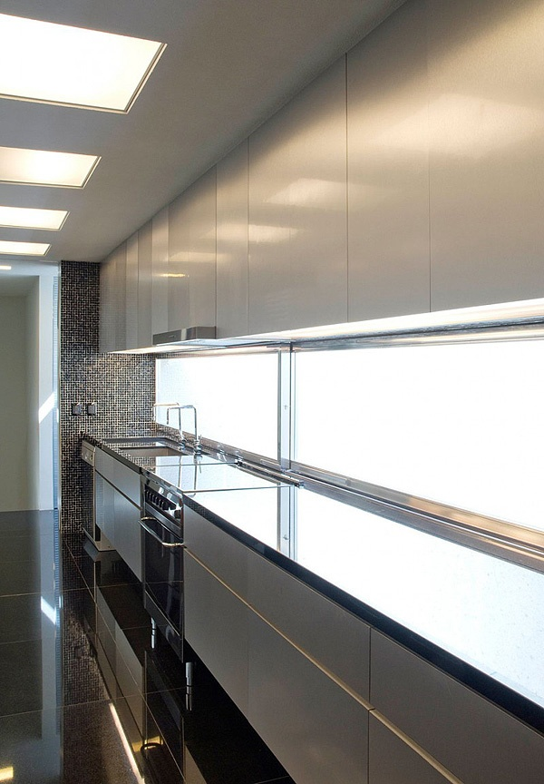 frosted glass splash back, slides open to reveal herb window boxes? Love the layout here... Imagine the laundry and toilet through the doors At back...Don't like the uber shiny surface or black floor.