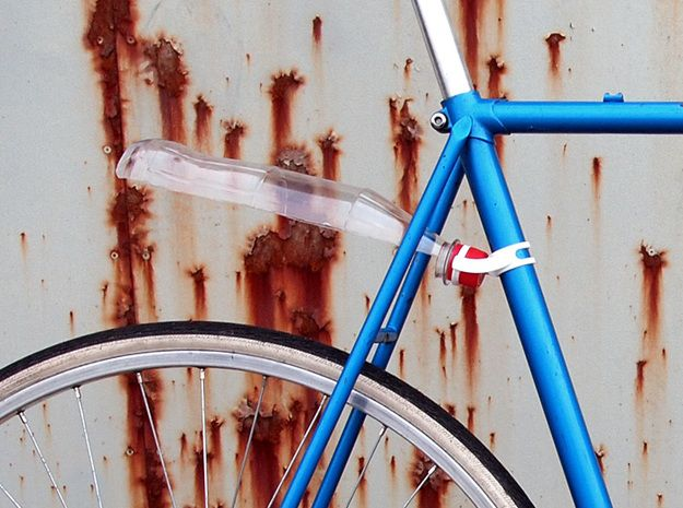 Getting splashed with water everytime you ride? Repurpose that water bottle to stay nice and dry.