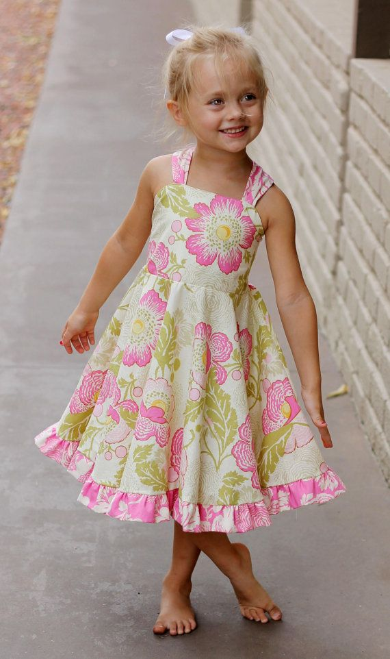 This darling dress has a big skirt that little girls love to twirl in! It also has criss cross straps that pleat in the front and back, with an